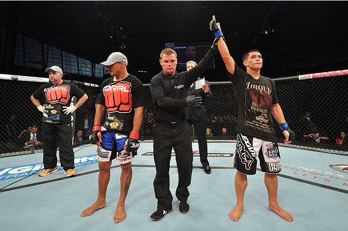 BARUERI, BRAZIL - OCTOBER 9:  (R-L) Chris Cariaso celebrates after defeating Iliarde Santos in their flyweight bout during the UFC Fight Night event at the Ginasio Jose Correa on October 9, 2013 in Barueri, Sao Paulo, Brazil. (Photo by Jeff Bottari/Zuffa