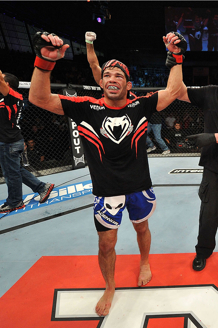BARUERI, BRAZIL - OCTOBER 9:  Rafael Assuncao celebrates after defeating TJ Dillashaw (not pictured) in their bantamweight bout during the UFC Fight Night event at the Ginasio Jose Correa on October 9, 2013 in Barueri, Sao Paulo, Brazil. (Photo by Jeff Bo