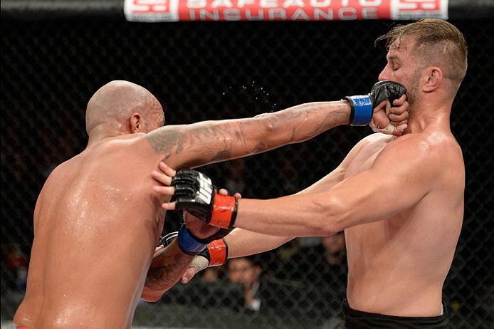 BARUERI, BRAZIL - OCTOBER 9:  (L-R) Joey Beltran punches Fabio Maldonado in their light heavyweight bout during the UFC Fight Night event at the Ginasio Jose Correa on October 9, 2013 in Barueri, Sao Paulo, Brazil. (Photo by Jeff Bottari/Zuffa LLC/Zuffa L