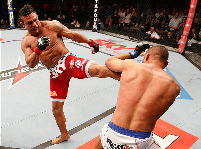 GOIANIA, BRAZIL - NOVEMBER 09:  (L-R) Vitor Belfort kicks Dan Henderson in their light heavyweight bout during the UFC event at Arena Goiania on November 9, 2013 in Goiania, Brazil. (Photo by Josh Hedges/Zuffa LLC/Zuffa LLC via Getty Images)