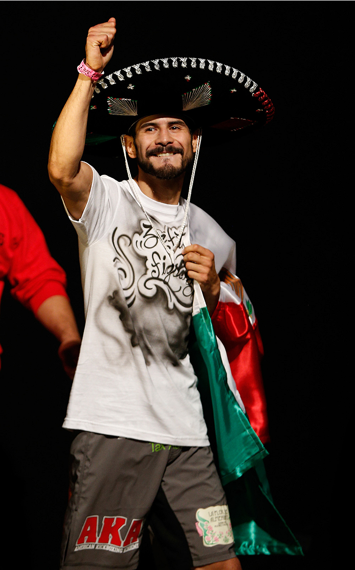 AUSTIN, TX - NOVEMBER 21:  Juan Puig of Mexico enters the arena during the UFC weigh-in at The Frank Erwin Center on November 21, 2014 in Austin, Texas.  (Photo by Josh Hedges/Zuffa LLC/Zuffa LLC via Getty Images)