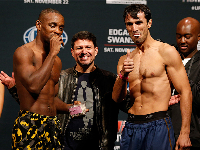 AUSTIN, TX - NOVEMBER 21:  (L-R) Opponents Yves Edwards of the Bahamas and Akbarh Arreola of Mexico share a snake after making weight during the UFC weigh-in at The Frank Erwin Center on November 21, 2014 in Austin, Texas.  (Photo by Josh Hedges/Zuffa LLC