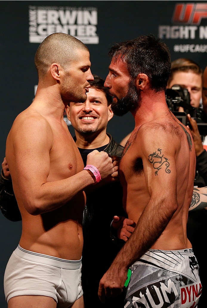 AUSTIN, TX - NOVEMBER 21:  (L-R) Opponents Matt Wiman and Isaac Vallie-Flagg face off during the UFC weigh-in at The Frank Erwin Center on November 21, 2014 in Austin, Texas.  (Photo by Josh Hedges/Zuffa LLC/Zuffa LLC via Getty Images)