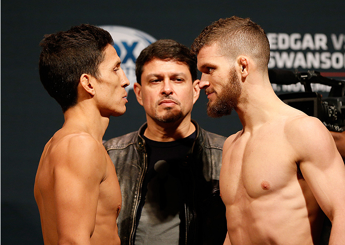 AUSTIN, TX - NOVEMBER 21:  (L-R) Opponents Joseph Benavidez and Dustin Ortiz face off during the UFC weigh-in at The Frank Erwin Center on November 21, 2014 in Austin, Texas.  (Photo by Josh Hedges/Zuffa LLC/Zuffa LLC via Getty Images)