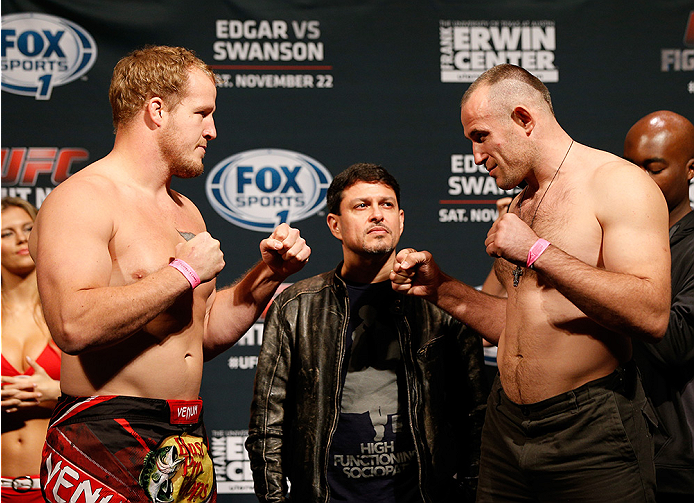 AUSTIN, TX - NOVEMBER 21:  (L-R) Opponents Jared Rosholt and Alexey Oliynyk of Russia face off during the UFC weigh-in at The Frank Erwin Center on November 21, 2014 in Austin, Texas.  (Photo by Josh Hedges/Zuffa LLC/Zuffa LLC via Getty Images)