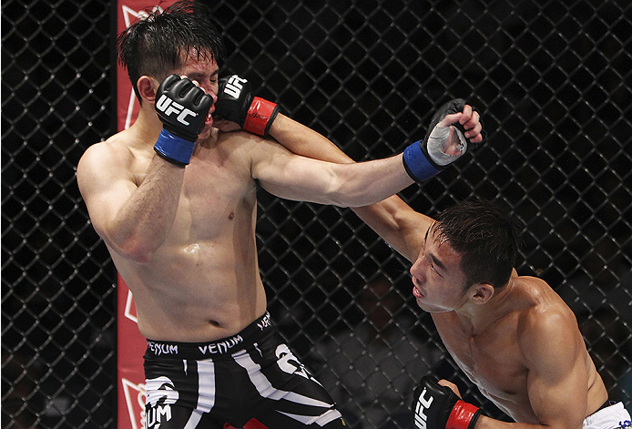 MACAU - AUGUST 23:  Yao Zhikui lands a punch on Royston Wee in their bantamweight fight during the UFC Fight Night event at the Venetian Macau on August 23, 2014 in Macau. (Photo by Mitch Viquez/Zuffa LLC/Zuffa LLC via Getty Images)