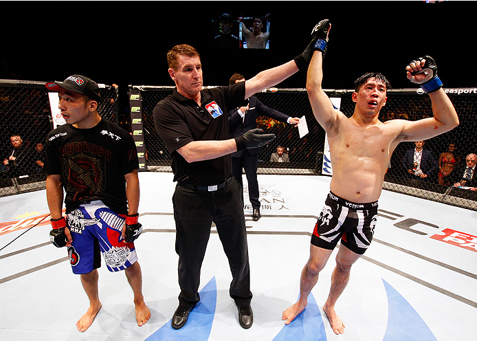 MACAU - AUGUST 23:  Royston Wee celebrates after his win over Yao Zhikui in their bantamweight fight during the UFC Fight Night event at the Venetian Macau on August 23, 2014 in Macau. (Photo by Mitch Viquez/Zuffa LLC/Zuffa LLC via Getty Images)