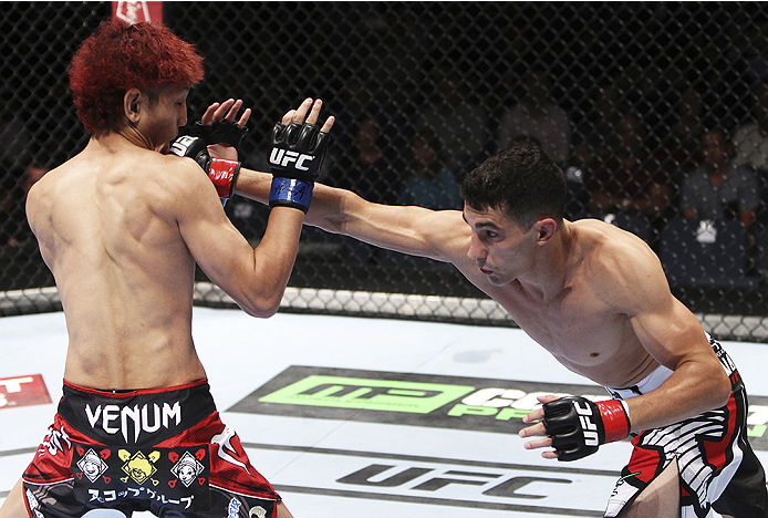 MACAU - AUGUST 23: Roland Delorme lands a punch on Yuta Sasaki  in their bantamweight fight during the UFC Fight Night event at the Venetian Macau on August 23, 2014 in Macau. (Photo by Mitch Viquez/Zuffa LLC/Zuffa LLC via Getty Images)