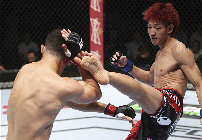 MACAU - AUGUST 23:  Yuta Sasaki kicks Roland Delorme in their bantamweight fight during the UFC Fight Night event at the Venetian Macau on August 23, 2014 in Macau. (Photo by Mitch Viquez/Zuffa LLC/Zuffa LLC via Getty Images)