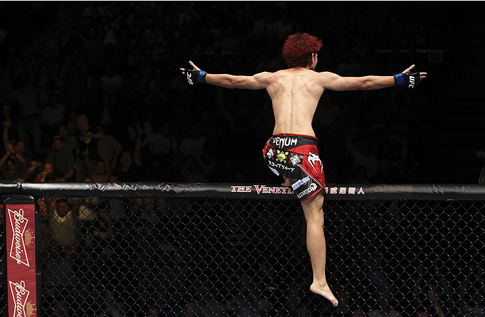 MACAU - AUGUST 23:  Yuta Sasaki celebrates his win over Roland Delorme in their bantamweight fight during the UFC Fight Night event at the Venetian Macau on August 23, 2014 in Macau. (Photo by Mitch Viquez/Zuffa LLC/Zuffa LLC via Getty Images)