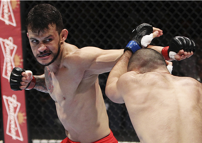 MACAU - AUGUST 23:  Alberto Mina punches Shinsho Anzai in their welterweight fight during the UFC Fight Night event at the Venetian Macau on August 23, 2014 in Macau. (Photo by Mitch Viquez/Zuffa LLC/Zuffa LLC via Getty Images)