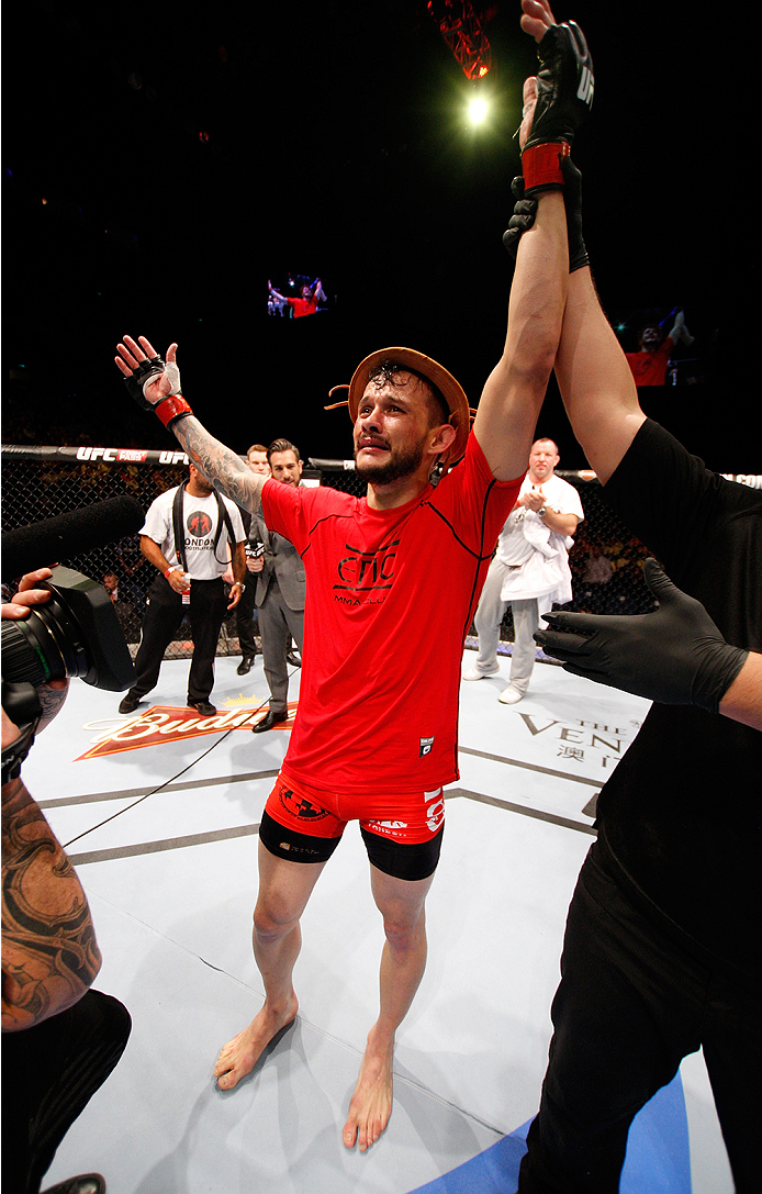 MACAU - AUGUST 23: Alberto Mina celebrates his win over Shinsho Anzai in their welterweight fight during the UFC Fight Night event at the Venetian Macau on August 23, 2014 in Macau. (Photo by Mitch Viquez/Zuffa LLC/Zuffa LLC via Getty Images)
