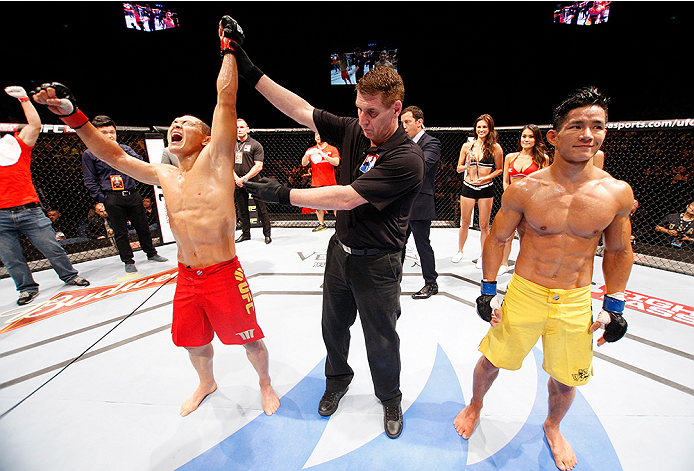 MACAU - AUGUST 23:  Ning Guangyou celebrates after defeating Yang Jianping in their featherweight fight during the UFC Fight Night event at the Venetian Macau on August 23, 2014 in Macau. (Photo by Mitch Viquez/Zuffa LLC/Zuffa LLC via Getty Images)