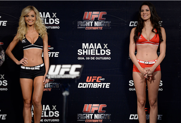 BARUERI, BRAZIL - OCTOBER 8:  (L-R) UFC Octagon Girls Jhenny Andrade and Camila Rodrigues de Oliveira stands on stage during the UFC Fight Night: Maia v Shields weigh-in at the Ginasio Jose Correa on October 8, 2013 in Barueri, Sao Paulo, Brazil. (Photo b