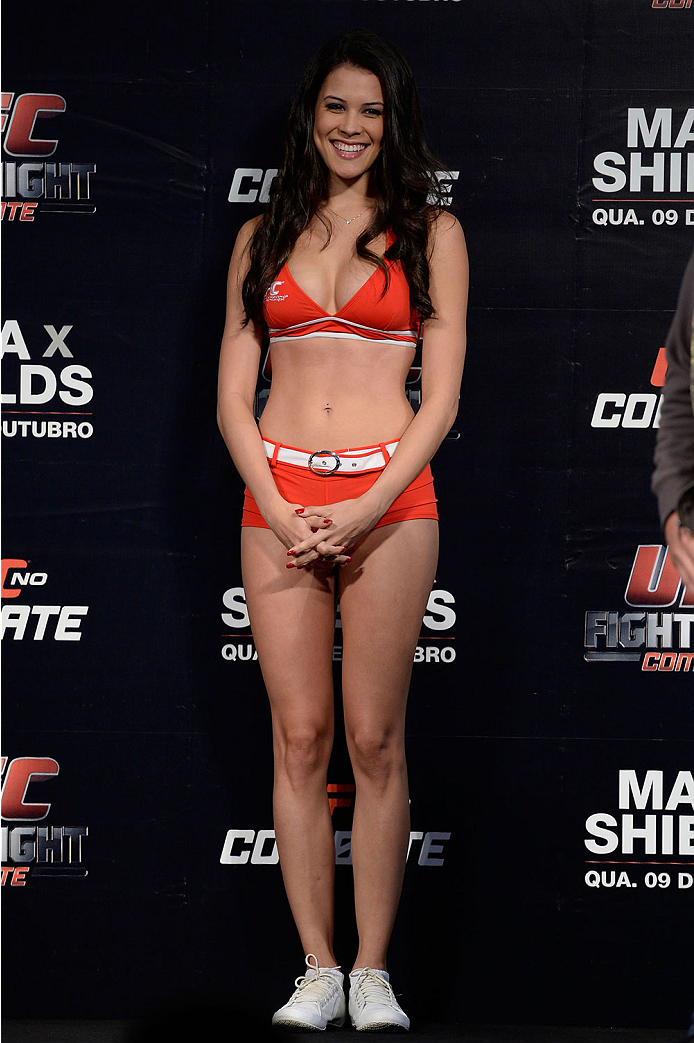 BARUERI, BRAZIL - OCTOBER 8:  UFC Octagon Girl Camila Rodrigues de Oliveira stands on stage during the UFC Fight Night: Maia v Shields weigh-in at the Ginasio Jose Correa on October 8, 2013 in Barueri, Sao Paulo, Brazil. (Photo by Jeff Bottari/Zuffa LLC/Z