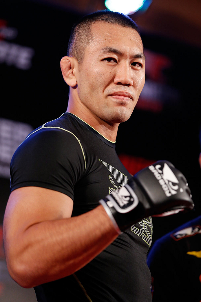 BELO HORIZONTE, BRAZIL - SEPTEMBER 02:  Yushin Okami poses for a photo after an open training session for media at the Ouro Minas Palace Hotel on September 2, 2013 in Belo Horizonte, Brazil. (Photo by Josh Hedges/Zuffa LLC/Zuffa LLC via Getty Images)