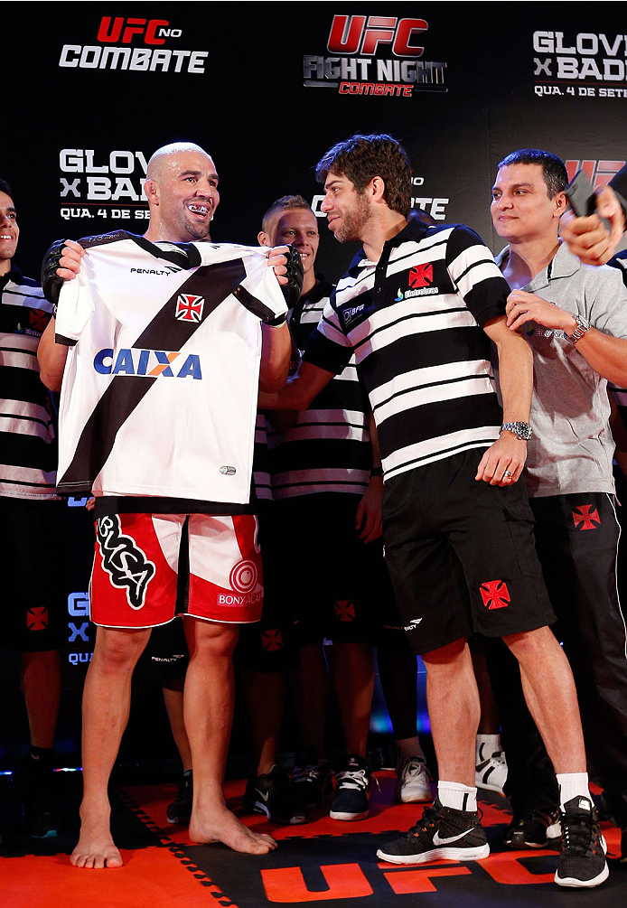BELO HORIZONTE, BRAZIL - SEPTEMBER 02:  (R-L) Juninho of Vasco da Gama presents Glover Teixeira with a jersey after an open training session for media at the Ouro Minas Palace Hotel on September 2, 2013 in Belo Horizonte, Brazil. (Photo by Josh Hedges/Zuf