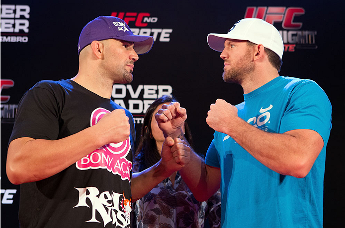 BELO HORIZONTE, BRAZIL - SEPTEMBER 02:  (L-R) Opponents Glover Teixeira and Ryan Bader face off after an open training session for media at the Ouro Minas Palace Hotel on September 2, 2013 in Belo Horizonte, Brazil. (Photo by Josh Hedges/Zuffa LLC/Zuffa L