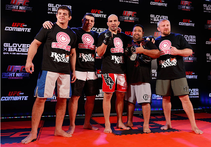 BELO HORIZONTE, BRAZIL - SEPTEMBER 02:  Glover Teixeira (center) poses for a photo with his team after an open training session for media at the Ouro Minas Palace Hotel on September 2, 2013 in Belo Horizonte, Brazil. (Photo by Josh Hedges/Zuffa LLC/Zuffa