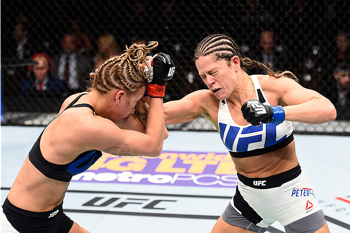 LAS VEGAS, NEVADA - DECEMBER 10:  (R) Emily Kagan punches Kailan Curran in their women's strawweight bout during the UFC Fight Night event at The Chelsea at the Cosmopolitan of Las Vegas on December 10, 2015 in Las Vegas, Nevada.  (Photo by Jeff Bottari/Z