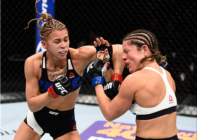 LAS VEGAS, NEVADA - DECEMBER 10:  (L) Kailan Curran punches Emily Kagan in their women's strawweight bout during the UFC Fight Night event at The Chelsea at the Cosmopolitan of Las Vegas on December 10, 2015 in Las Vegas, Nevada.  (Photo by Jeff Bottari/Z
