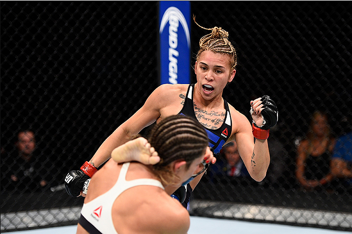 LAS VEGAS, NEVADA - DECEMBER 10:  (R) Kailan Curran kicks Emily Kagan in their women's strawweight bout during the UFC Fight Night event at The Chelsea at the Cosmopolitan of Las Vegas on December 10, 2015 in Las Vegas, Nevada.  (Photo by Jeff Bottari/Zuf