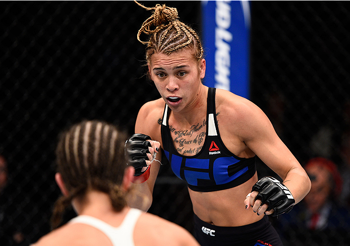 LAS VEGAS, NEVADA - DECEMBER 10:  (R) Kailan Curran squares off with Emily Kagan in their women's strawweight bout during the UFC Fight Night event at The Chelsea at the Cosmopolitan of Las Vegas on December 10, 2015 in Las Vegas, Nevada.  (Photo by Jeff