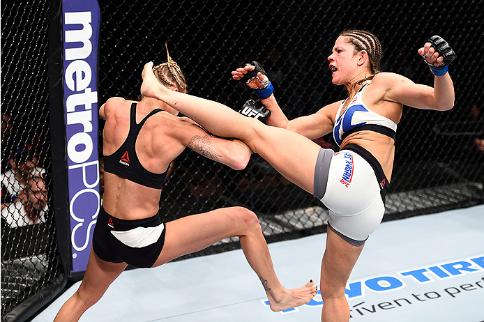 LAS VEGAS, NEVADA - DECEMBER 10:  (R) Emily Kagan kicks Kailan Curran in their women's strawweight bout during the UFC Fight Night event at The Chelsea at the Cosmopolitan of Las Vegas on December 10, 2015 in Las Vegas, Nevada.  (Photo by Jeff Bottari/Zuf