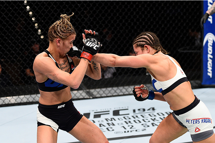 LAS VEGAS, NEVADA - DECEMBER 10: (R) Emily Kagan punches Kailan Curran in their women's strawweight bout during the UFC Fight Night event at The Chelsea at the Cosmopolitan of Las Vegas on December 10, 2015 in Las Vegas, Nevada.  (Photo by Jeff Bottari/Zu