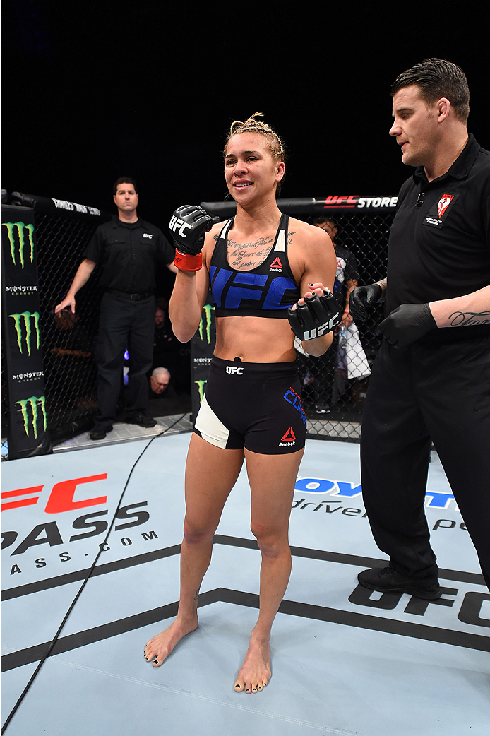 LAS VEGAS, NEVADA - DECEMBER 10:  Kailan Curran celebrates her win over Emily Kagan in their women's strawweight bout during the UFC Fight Night event at The Chelsea at the Cosmopolitan of Las Vegas on December 10, 2015 in Las Vegas, Nevada.  (Photo by Je