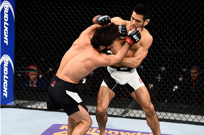 LAS VEGAS, NEVADA - DECEMBER 10:  (L) Zubaira Tukhugov and Phillipe Nover exchange punches in their featherweight bout during the UFC Fight Night event at The Chelsea at the Cosmopolitan of Las Vegas on December 10, 2015 in Las Vegas, Nevada.  (Photo by J