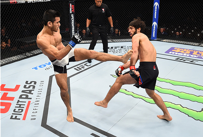 LAS VEGAS, NEVADA - DECEMBER 10:  (L) Phillipe Nover kicks Zubaira Tukhugov in their featherweight bout during the UFC Fight Night event at The Chelsea at the Cosmopolitan of Las Vegas on December 10, 2015 in Las Vegas, Nevada.  (Photo by Jeff Bottari/Zuf