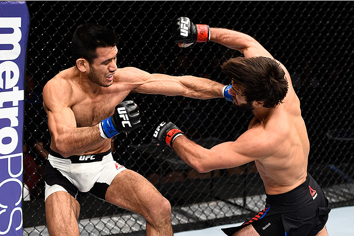 LAS VEGAS, NEVADA - DECEMBER 10: (L) Phillipe Nover punches Zubaira Tukhugov in their featherweight bout during the UFC Fight Night event at The Chelsea at the Cosmopolitan of Las Vegas on December 10, 2015 in Las Vegas, Nevada.  (Photo by Jeff Bottari/Zu