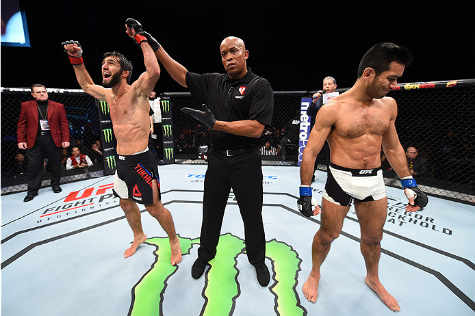 LAS VEGAS, NEVADA - DECEMBER 10:  (L) Zubaira Tukhugov celebrates his win over Phillipe Nover in their featherweight bout during the UFC Fight Night event at The Chelsea at the Cosmopolitan of Las Vegas on December 10, 2015 in Las Vegas, Nevada.  (Photo b