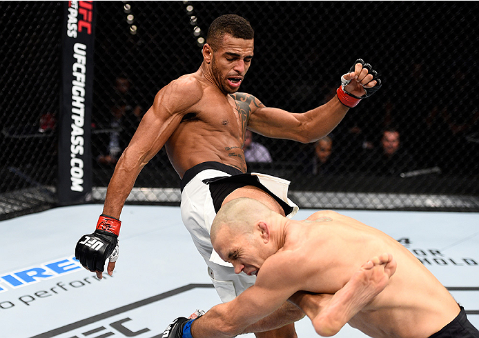 LAS VEGAS, NEVADA - DECEMBER 10:  (L) Danny Roberts kicks Nathan Coy in their welterweight bout during the UFC Fight Night event at The Chelsea at the Cosmopolitan of Las Vegas on December 10, 2015 in Las Vegas, Nevada.  (Photo by Jeff Bottari/Zuffa LLC/Z