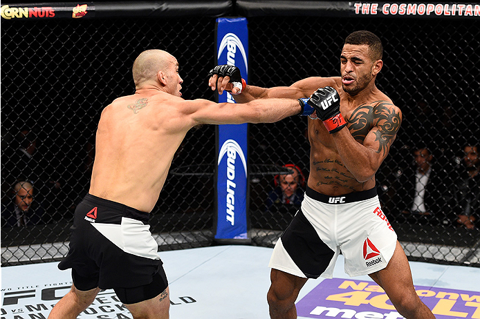 LAS VEGAS, NEVADA - DECEMBER 10:  (L) Nathan Coy and Danny Roberts exchange punches in their welterweight bout during the UFC Fight Night event at The Chelsea at the Cosmopolitan of Las Vegas on December 10, 2015 in Las Vegas, Nevada.  (Photo by Jeff Bott