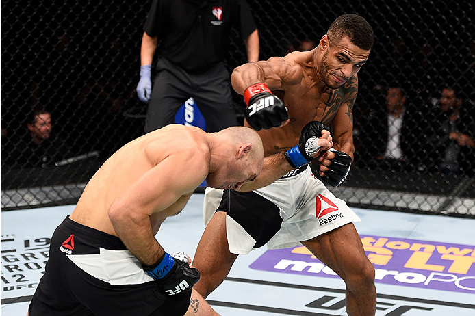 LAS VEGAS, NEVADA - DECEMBER 10:  (Top) Danny Roberts punches Nathan Coy in their welterweight bout during the UFC Fight Night event at The Chelsea at the Cosmopolitan of Las Vegas on December 10, 2015 in Las Vegas, Nevada.  (Photo by Jeff Bottari/Zuffa L