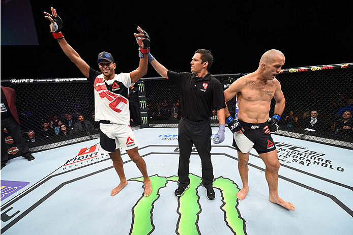 LAS VEGAS, NEVADA - DECEMBER 10:  (L) Danny Roberts celebrates his win over Nathan Coy in their welterweight bout during the UFC Fight Night event at The Chelsea at the Cosmopolitan of Las Vegas on December 10, 2015 in Las Vegas, Nevada.  (Photo by Jeff B