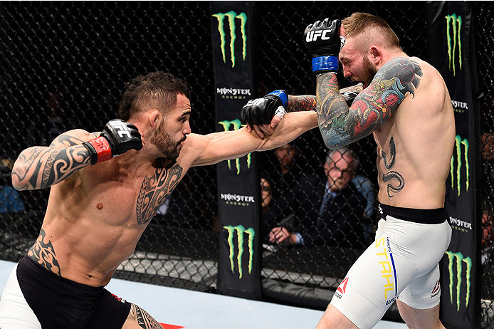 LAS VEGAS, NEVADA - DECEMBER 10:  (L) Santiago Ponzinibbio punches Andreas Stahl in their welterweight bout during the UFC Fight Night event at The Chelsea at the Cosmopolitan of Las Vegas on December 10, 2015 in Las Vegas, Nevada.  (Photo by Jeff Bottari