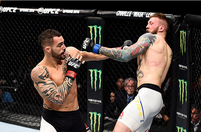LAS VEGAS, NEVADA - DECEMBER 10:  (L) Santiago Ponzinibbio exchanges punches with Andreas Stahl in their welterweight bout during the UFC Fight Night event at The Chelsea at the Cosmopolitan of Las Vegas on December 10, 2015 in Las Vegas, Nevada.  (Photo