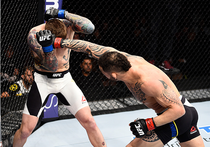 LAS VEGAS, NEVADA - DECEMBER 10:  (R) Santiago Ponzinibbio punches Andreas Stahl in their welterweight bout during the UFC Fight Night event at The Chelsea at the Cosmopolitan of Las Vegas on December 10, 2015 in Las Vegas, Nevada.  (Photo by Jeff Bottari