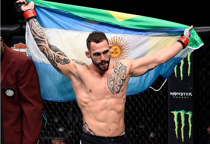 LAS VEGAS, NEVADA - DECEMBER 10:  Santiago Ponzinibbio celebrates his win over Andreas Stahl in their welterweight bout during the UFC Fight Night event at The Chelsea at the Cosmopolitan of Las Vegas on December 10, 2015 in Las Vegas, Nevada.  (Photo by
