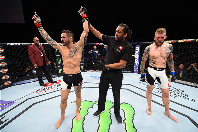 LAS VEGAS, NEVADA - DECEMBER 10:  (L) Santiago Ponzinibbio celebrates his win over Andreas Stahl in their welterweight bout during the UFC Fight Night event at The Chelsea at the Cosmopolitan of Las Vegas on December 10, 2015 in Las Vegas, Nevada.  (Photo