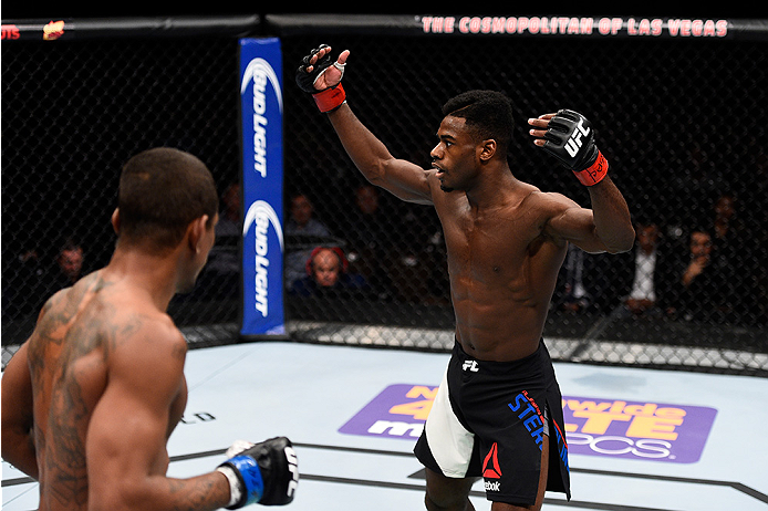 LAS VEGAS, NEVADA - DECEMBER 10:  (R) Aljamain Sterling hypes up the crowd in his bantamweight bout against Johnny Eduardo during the UFC Fight Night event at The Chelsea at the Cosmopolitan of Las Vegas on December 10, 2015 in Las Vegas, Nevada.  (Photo