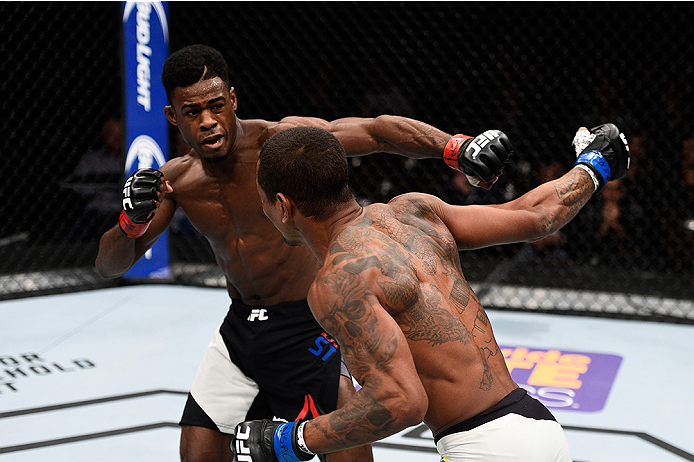 LAS VEGAS, NEVADA - DECEMBER 10:  (R) Johnny Eduardo punches Aljamain Sterling in their bantamweight bout during the UFC Fight Night event at The Chelsea at the Cosmopolitan of Las Vegas on December 10, 2015 in Las Vegas, Nevada.  (Photo by Jeff Bottari/Z