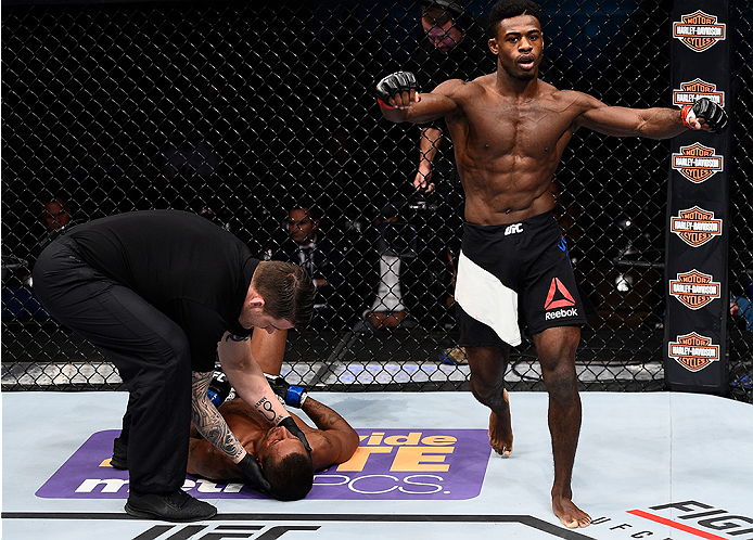 LAS VEGAS, NEVADA - DECEMBER 10:  (R) Aljamain Sterling celebrates his win over Johnny Eduardo in their bantamweight bout during the UFC Fight Night event at The Chelsea at the Cosmopolitan of Las Vegas on December 10, 2015 in Las Vegas, Nevada.  (Photo b