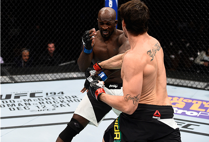 LAS VEGAS, NEVADA - DECEMBER 10:  (R) Antonio Carlos Junior punches Kevin Casey in their middleweight bout during the UFC Fight Night event at The Chelsea at the Cosmopolitan of Las Vegas on December 10, 2015 in Las Vegas, Nevada.  (Photo by Jeff Bottari/