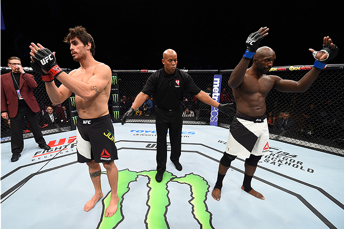 LAS VEGAS, NEVADA - DECEMBER 10:  (L) Antonio Carlos Junior and Kevin Casey react to the no contest decision after an accidental eye poke in their middleweight bout during the UFC Fight Night event at The Chelsea at the Cosmopolitan of Las Vegas on Decemb