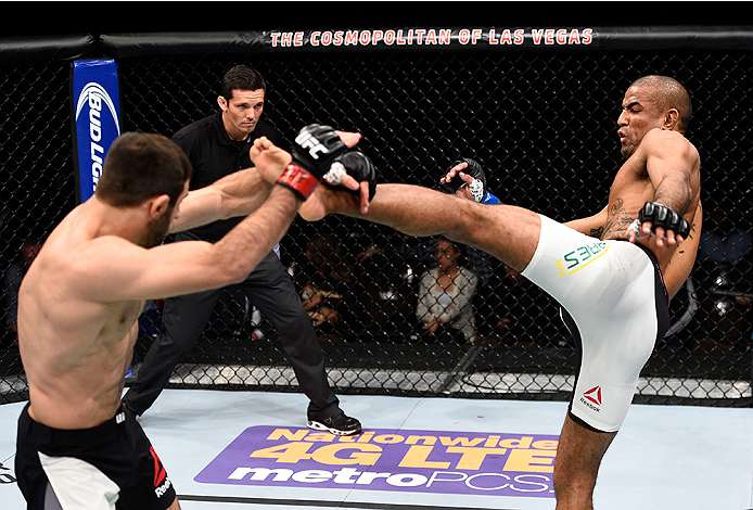 LAS VEGAS, NEVADA - DECEMBER 10:  (R) Sergio Moraes kicks Omari Akhmedov in their welterweight bout during the UFC Fight Night event at The Chelsea at the Cosmopolitan of Las Vegas on December 10, 2015 in Las Vegas, Nevada.  (Photo by Jeff Bottari/Zuffa L