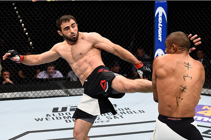 LAS VEGAS, NEVADA - DECEMBER 10:  (L) Omari Akhmedov kicks Sergio Moraes in their welterweight bout during the UFC Fight Night event at The Chelsea at the Cosmopolitan of Las Vegas on December 10, 2015 in Las Vegas, Nevada.  (Photo by Jeff Bottari/Zuffa L